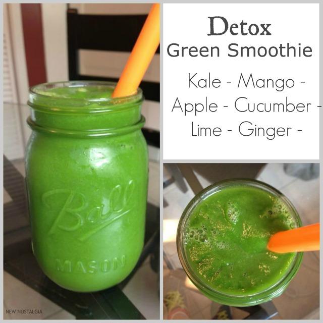 Detox green smoothie in mason jar with orange straw