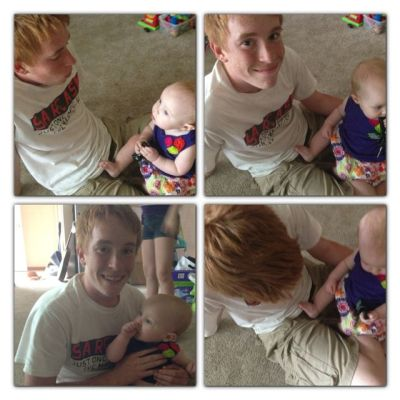 Nephew playing with baby Niece