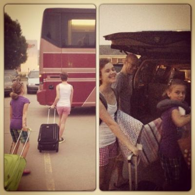 Young girls loading the bus for summer camp