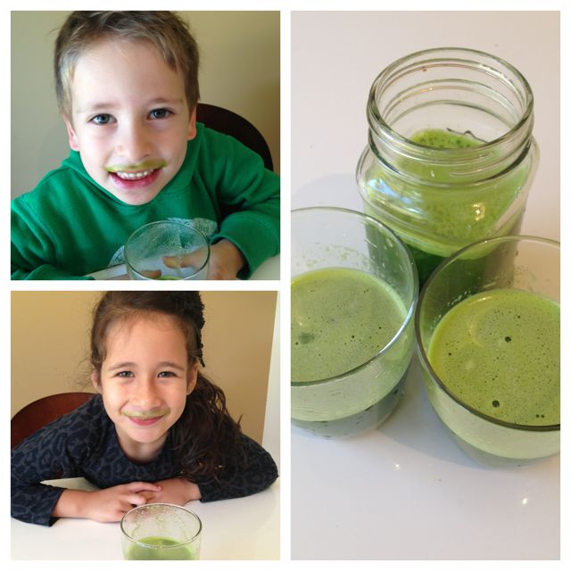 kids drinking green juice with green mustaches