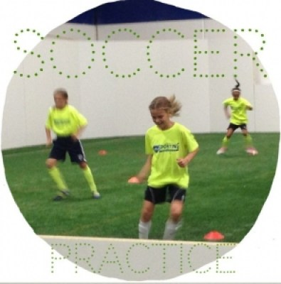 a nine year old girl playing soccer at soccer practice