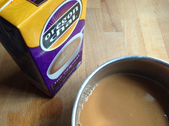 a box of chai concentrate and a pan of chai
