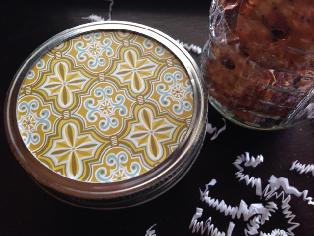 printed paper cut to fit in a mason jar lid jar of snacks