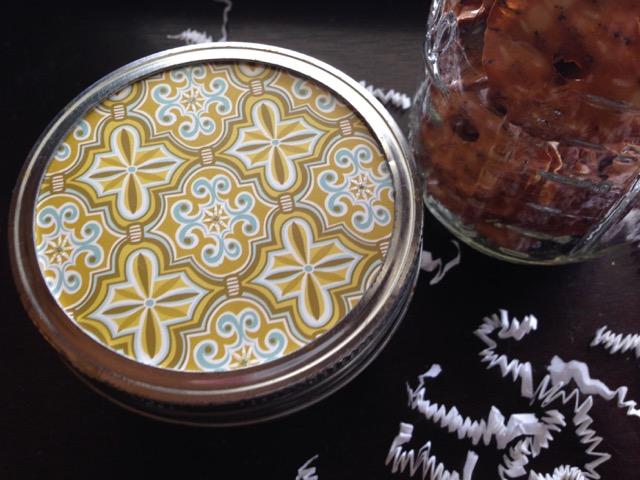 printed paper cut to fit in a mason jar lid jar of snacks