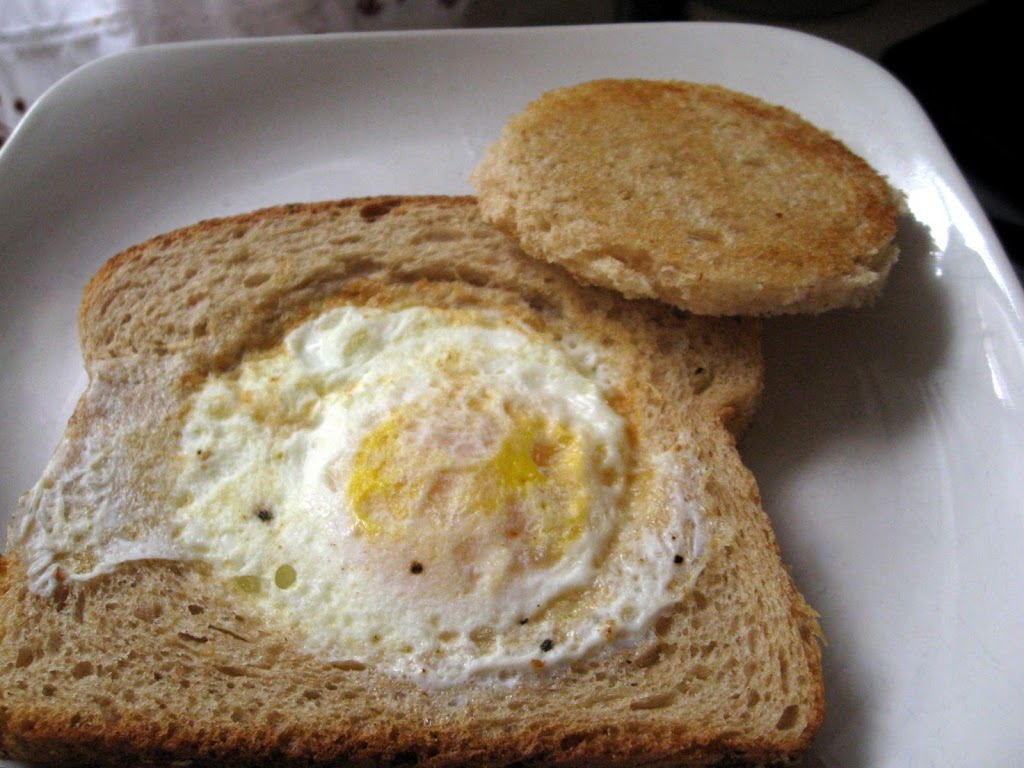 piece of bread with an egg cooked inside of it