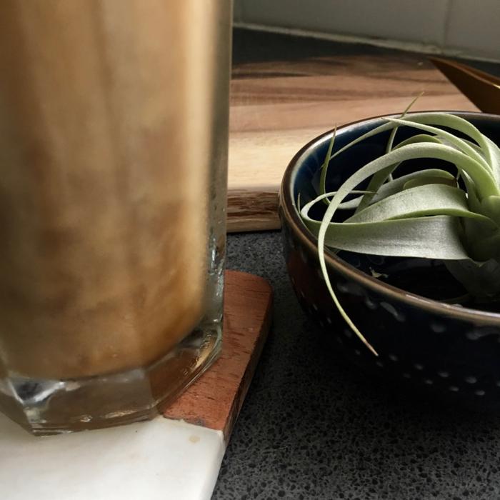 glass of creamy cold brew coffee