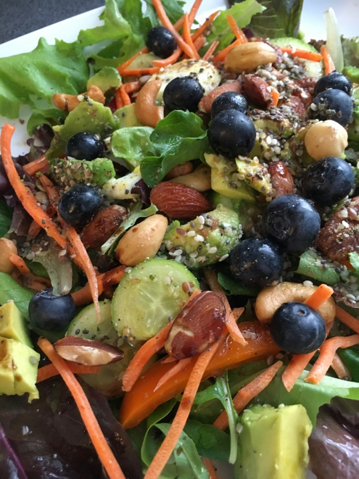 Bowl of Salad with mixed vegetables, berries and superseed mix