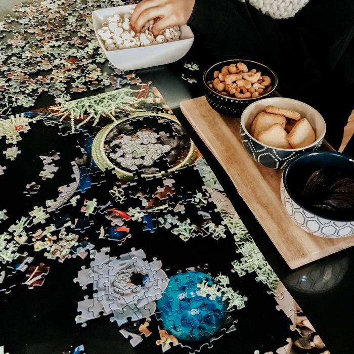 puzzle and snacks on a table