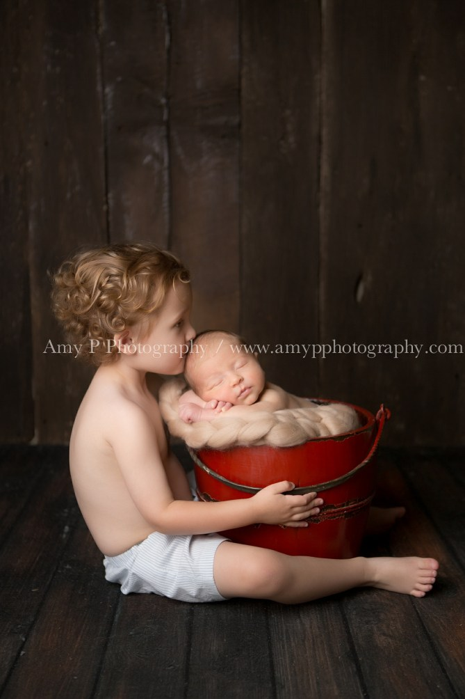 Newborn baby boy and his brother at the studio