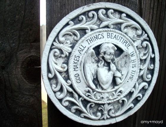 ceramic angel sign