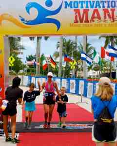 Crossing the finish line of my first half-iron distance triathlon with my kids.
