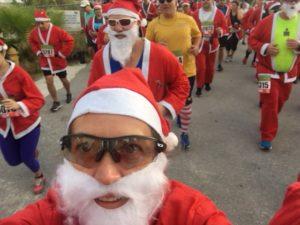 Amy dressed as Santa running