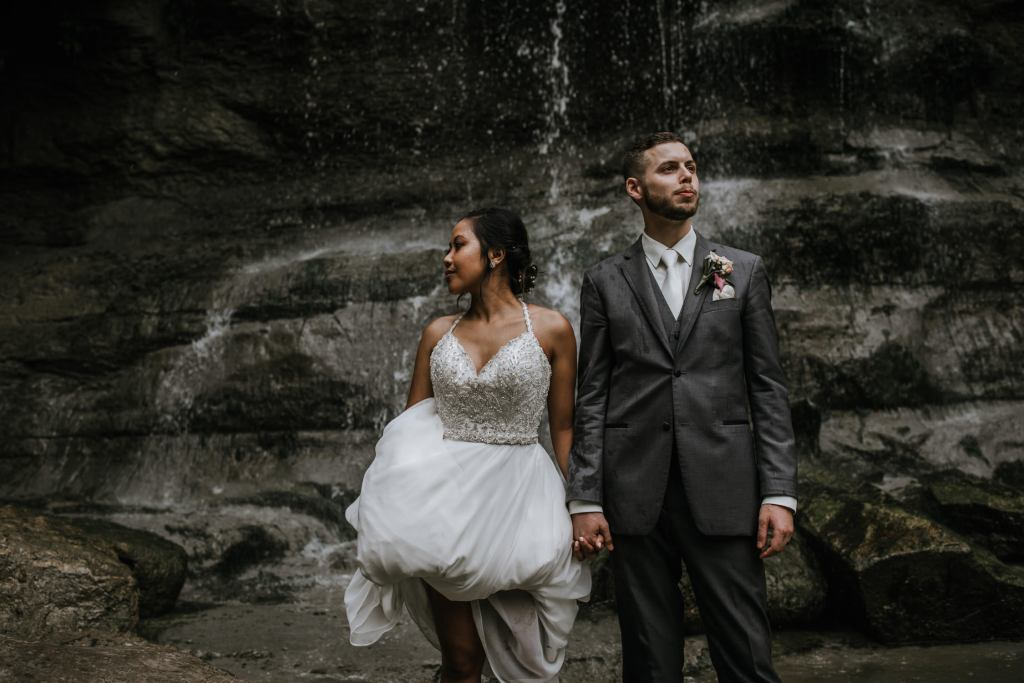 wedding photo of a couple in front of a waterfall