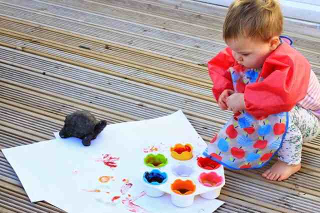 toddler playing with edible finger paints