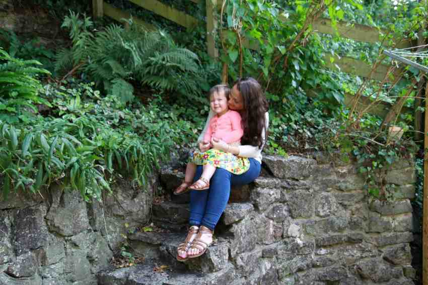mother and toddler sitting in the garden