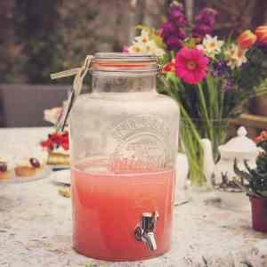 Kilner drinks dispenser filled with pink lemonade at an Alice in Wonderland themed tea party