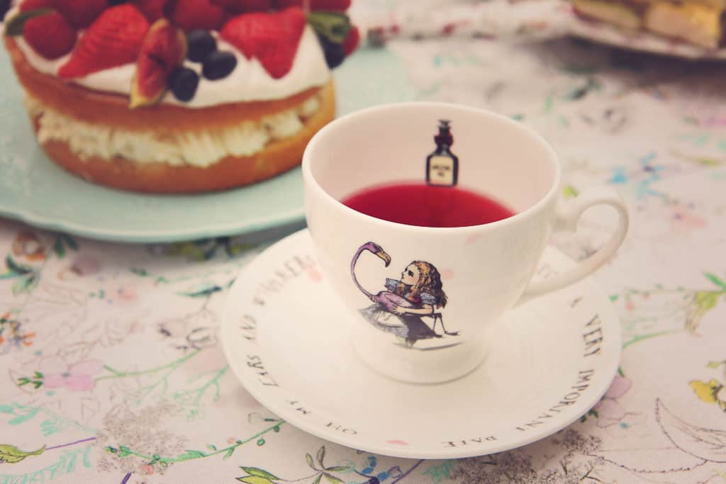 A teacup with 'pink tea' from the Alice in Wonderland collection