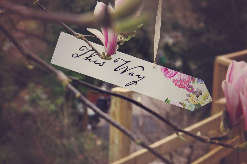 'This Way' sign from an Alice in Wonderland tea party