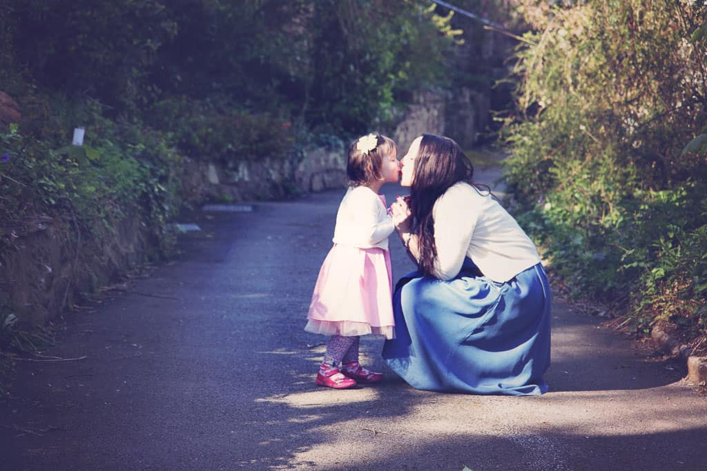 Mother and daughter kiss!