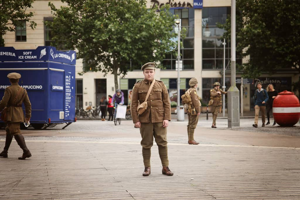 A young ma stands on the waterfront commemorating the battle of the somme