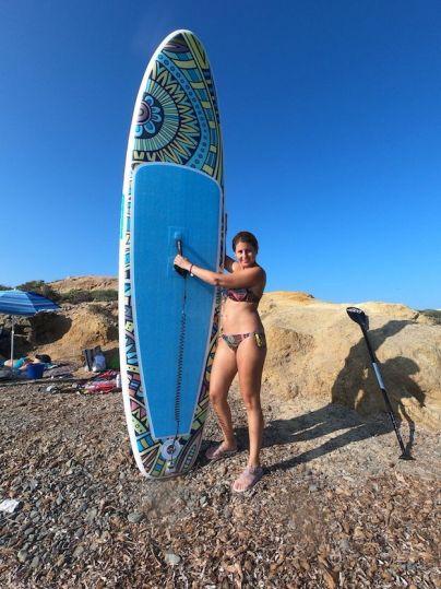 Con la tabla paddle surf