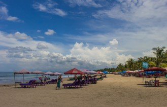 Sure there were a lot of sun loungers in Kuta, but no one puked on me, so.....not as described.