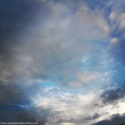 blue sky behind clouds