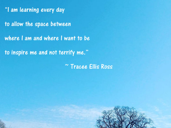 Blue sky with light clouds, top of a bare tree and quote by Tracee Ellis Ross.