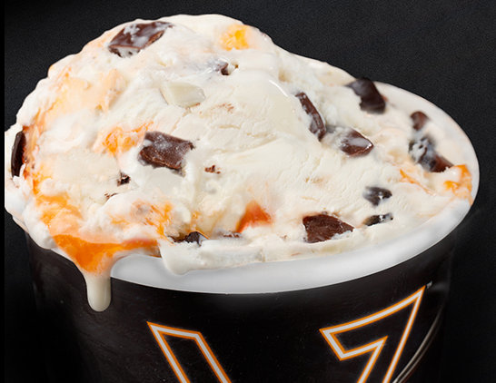 Vanilla ice cream with orange ripple, dark, white and milk chocolate chunks.