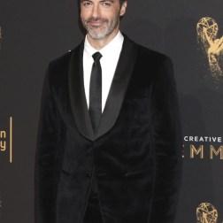 El actor estadounidense Reid Scott posa a su llegada a la ceremonia de entrega de los premios Emmy a las Artes Creativas celebrada en Los Ángeles