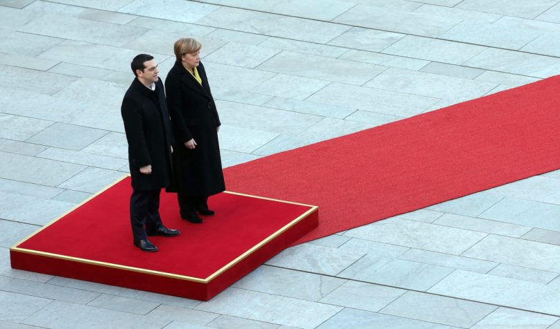 BERLIN, GERMANY - MARCH 23: Greek Prime Minister Alexis Tsipras (L) attends a military welcome ceremony with German Chancellor Angela Merkel upon Tsipras' arrival for talks at the German federal Chancellery on March 23, 2015 in Berlin, Germany. The two leaders are meeting as relations between the Tsipras government and Germany have soured amidst contrary views between the two countries on how Greece can best work itself out of its current economic morass. (Photo by Adam Berry/Getty Images)