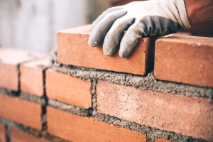 Man laying red brick