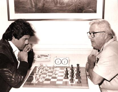 William Windom (right) playing chess against Erik Estrada, image from Anatoly Karpov Chess School
