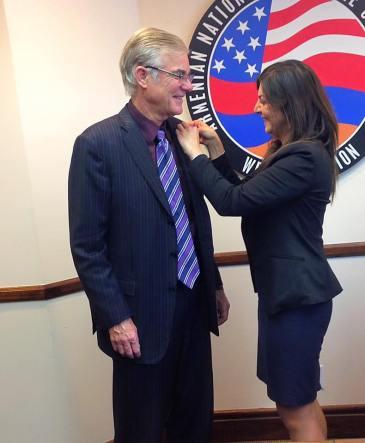 ANCA-WR Executive Director Elen Asatryan gifts Superintendent Torlakson with the original ANCA pin