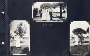 Photo album page with three photos of young women and men, one in uniform.