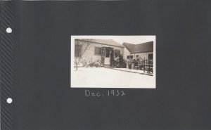 Photo with snow on the ground in front of a house, Dec. 1932