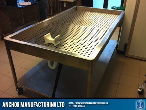 Mortuary table fabricated from Sheffield stainless steel.