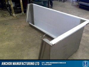 Custom designed steel urinal trough.