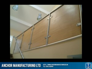 Sheffield steel balustrade with wood panels.