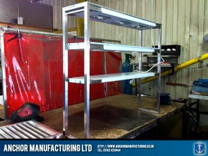 Three tiered heated gantry in stainless steel.