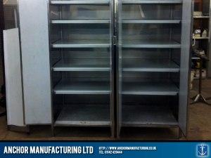 Steel kitchen storage cupboards multi shelved.