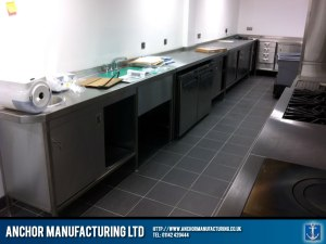Stainless steel kitchen wall benches and sinks.