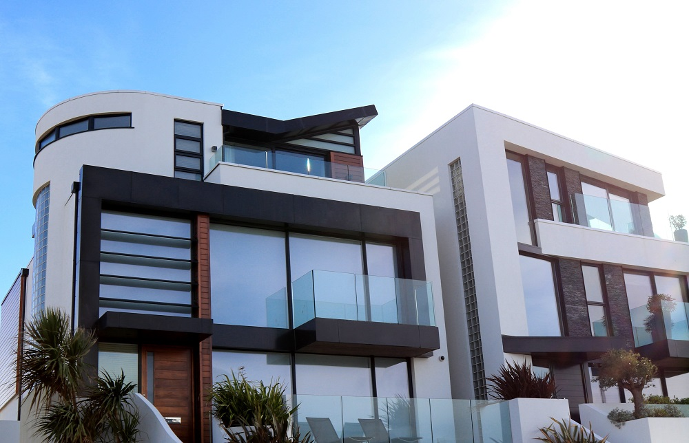 White wall building with glazed windwos and aluminium frames