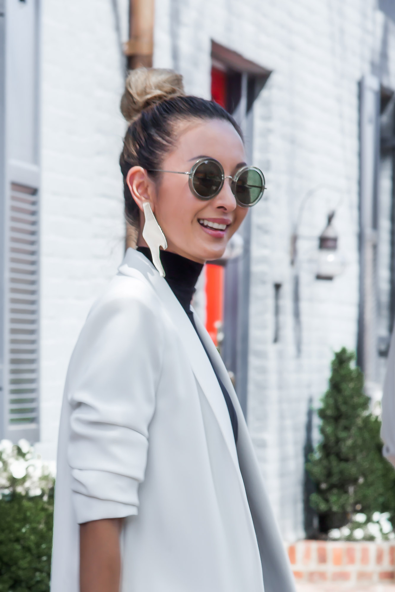 Anchyi Adorned in sheer trend with Tory Sport track pants, white blazer and Stella Valle bracelets.