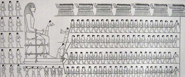 Depiction of workers moving a colossus