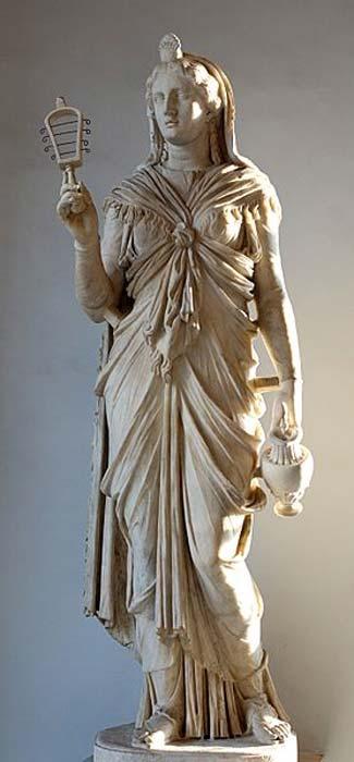 Estatua romana de Isis con un sistro y un enócoe. (Public Domain)
