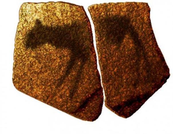 Impresión artística de un pictograma zoomórfico en la losa de piedra de la MSA de la cueva Apollo 11, Namibia (dominio público)