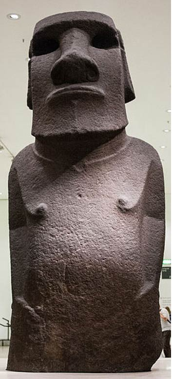 "Easter Island: Front view of moai statue made of basalt, called Hoa Hakananai'a (""Stolen or Hidden Friend""), from Orongo, Easter Island (Rapa Nui), Polynesia. Notice how the statue's hands wrap around to the navel."