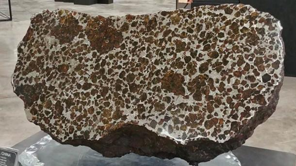 This is the main mass of the Fukang meteorite, on display in the Michael J. Drake building at the University of Arizona in Tucson.Note the large olivine nodules. Nicholas Silvestri