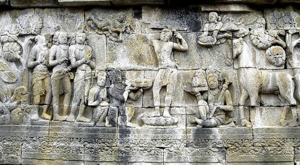 Prince Siddharta Gautama shaves the hair off his head as the sign to decline his status as ksatriya (warrior class) and becomes an ascetic hermit, his servants hold his sword, crown, and princely jewelry while his horse Kanthaka stands on right. Bas-relief panel at Borobudur, Java, Indonesia.